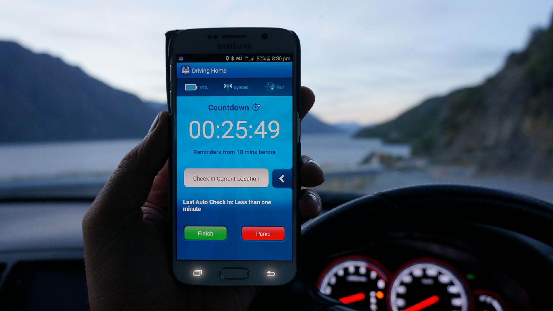 GetHomeSafe application shown on phone screen with car dashboard in background